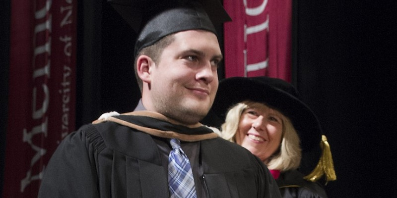 Chris Lukeman crosses the stage during Memorial's fall 2015 convocation ceremony. Chris Lukeman, Memorial University's fall 2015 convocation ceremony.