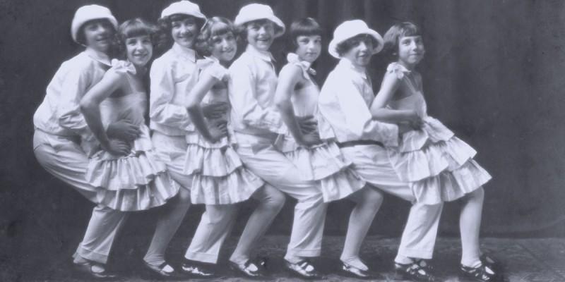 The Rossley Kiddies vaudeville troup members dance in a line.