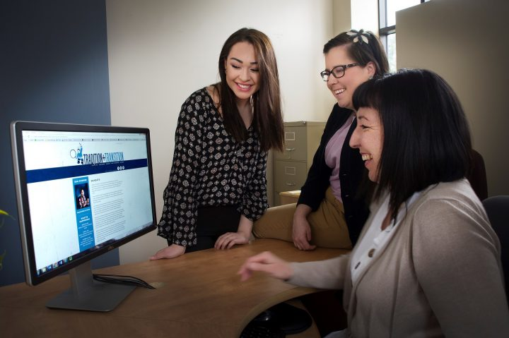 Bryanna Brown, Vicky Allen and Catharyn Andersen view the new Tradition and Transition website.