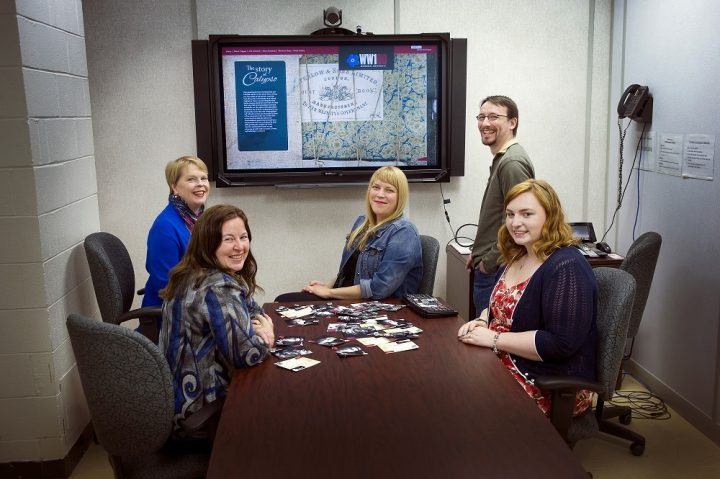 Members of the Remembering Calypso project team meet to review the new website. Left to Right – Tracy Keeping, Katie Lawton, Danielle Percy, Scott Bruce and Jessica Cahill. Missing from photo are Mark Wareham and Paul Ryan.
