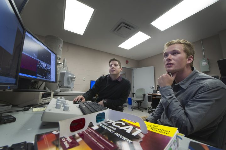 From left are Dr. David Grant and Daniel Rees in the CREAIT Network lab.