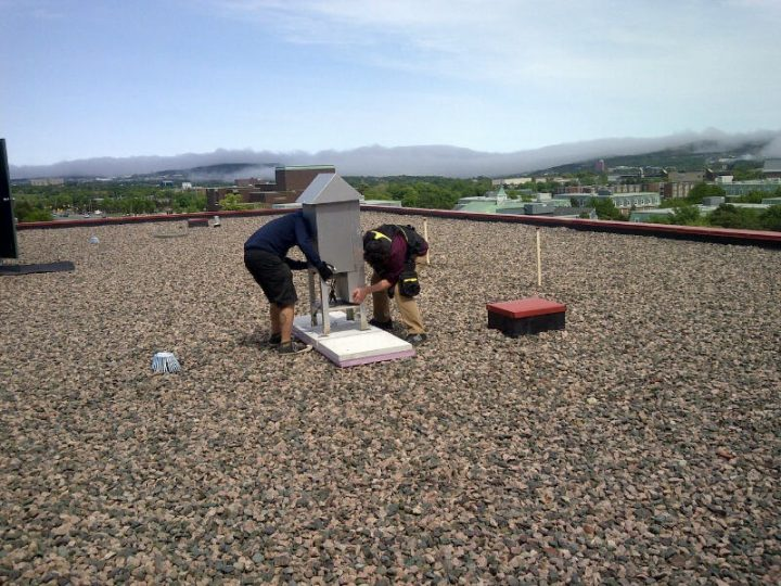 Taking air samples from atop the Earth Sciences building.