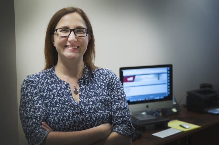 Dr. Ginny Fugarino, business application trainer with Research Grant and Contract Services, works with The Memorial Researcher Portal.