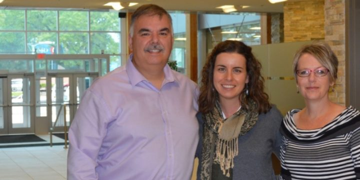 Caption: Dr. Roza Tchoukaleyska, centre, Corner Brook's mayor Charles Pender and Colleen Kennedy from