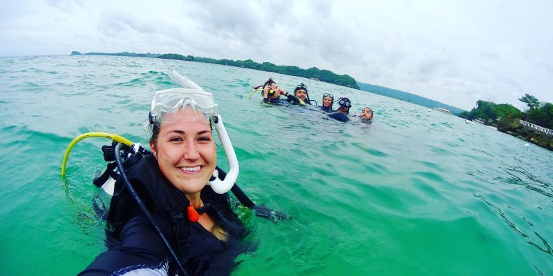 Christa Sandall and colleagues assist with a marine survey in the Philippines.