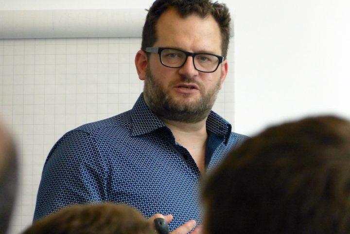 Dr. Liam Swiss presenting during a colloquium in October.