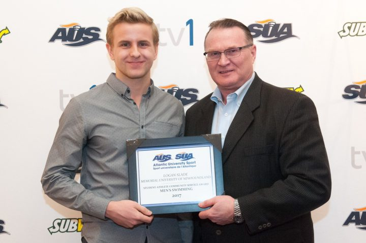 At left, Logan Slade receives the AUS Student-Athlete Community Service Award in PEI.