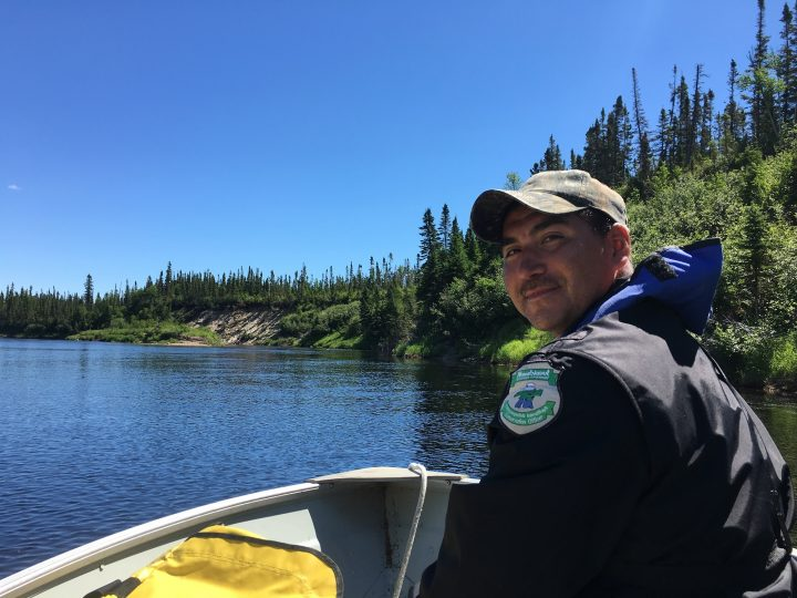 Joseph Townley, conservation officer, Nunatsiavut Government, helps the research team access a local Labrador river.