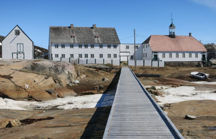 From left are Hopedale's store, mission house and church.