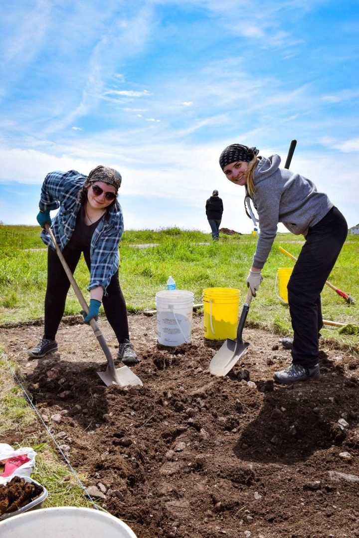 From left, Nancy Butler and Rachael Green excavate at Anse à Bertrand as part of the summer field school associated with Dr. Catherine Losier's research at Memorial.