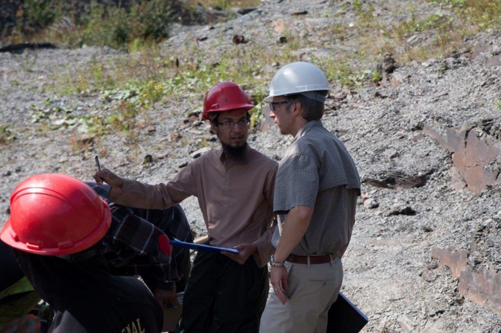 From left, Mejbah Sarker and Geoff Rideout conduct field trials on a tool to measure vibrations near the drill bit at a quarry in C.B.S. in 2014.