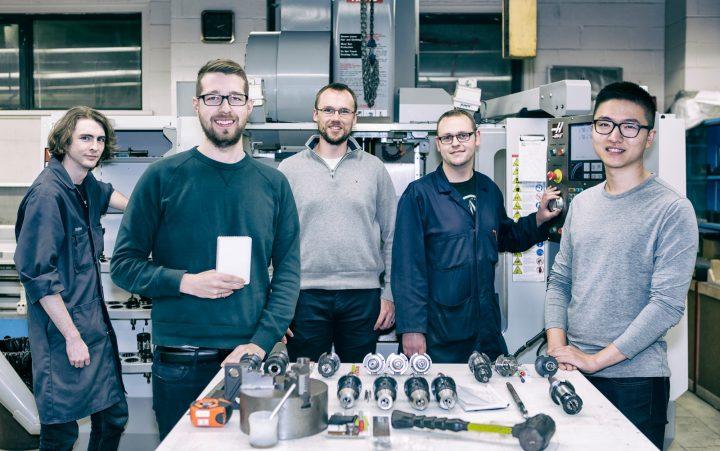 Members of the Empowered Homes and Technical Services teams in front of the CNC (computer numerical control) machine. From left: Matthew Fudge, mechanical technologist; Technical Services; Zachary Green, co-founder Empowered Homes; Jason Stevans, project engineer, Technical Services; Bradley Hefford, machinist, Technical Services; Kon Yue, mechanical engineering student.
