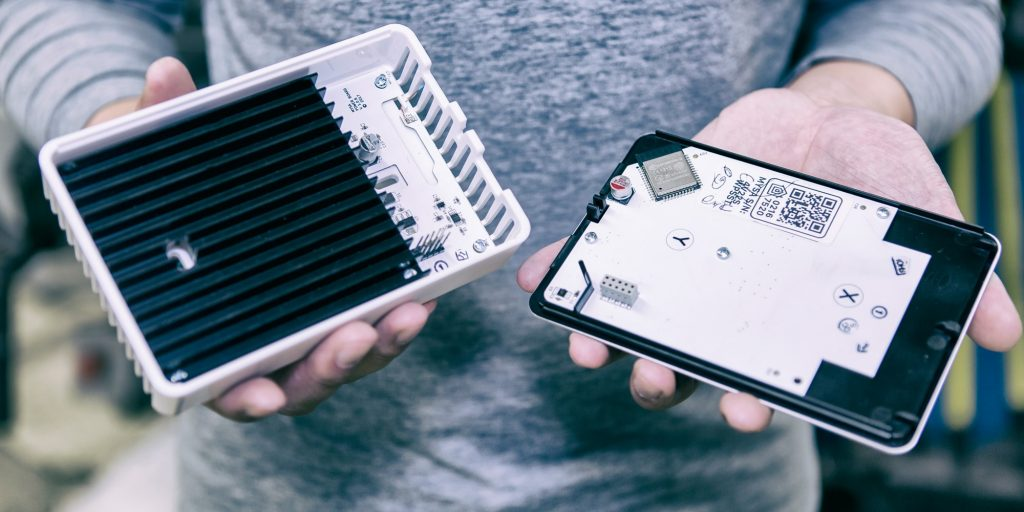 The inside of an Empowered Homes Mysa Smart Thermostat showing the casing and heatsink fabricated by Technical Services
