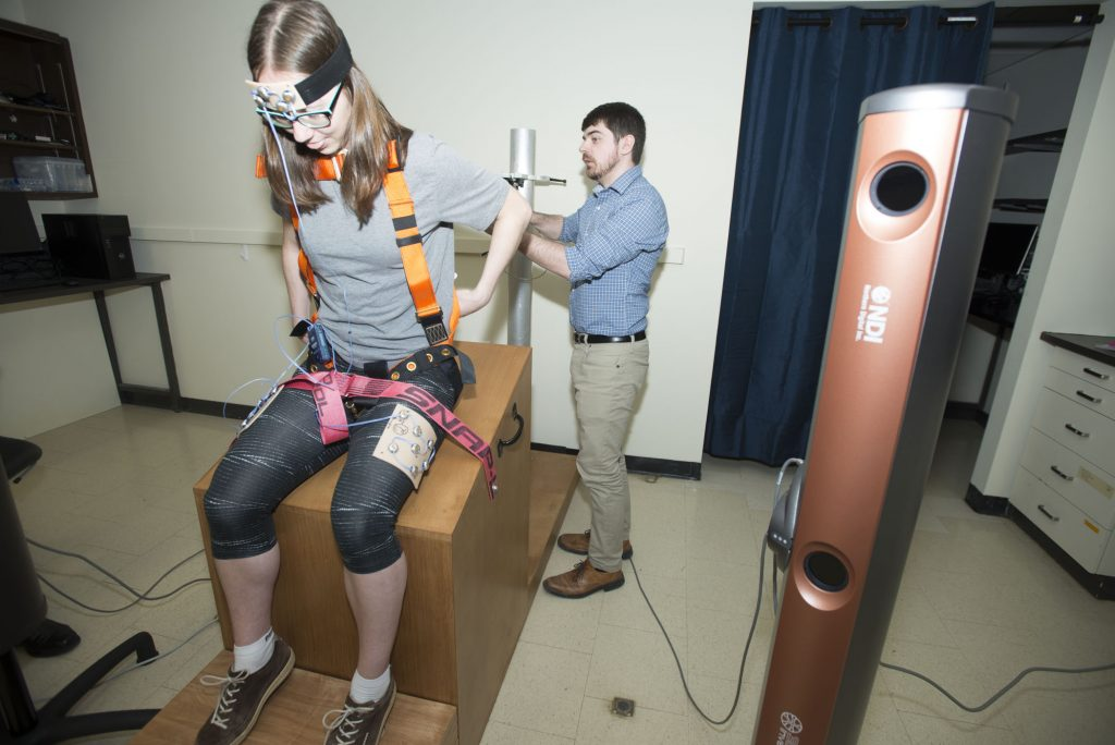 From left Mona Frey, co-op student, and Ryan Greene, a masters student, work with some of the equipment funded by the Canada Foundation for Innovation.