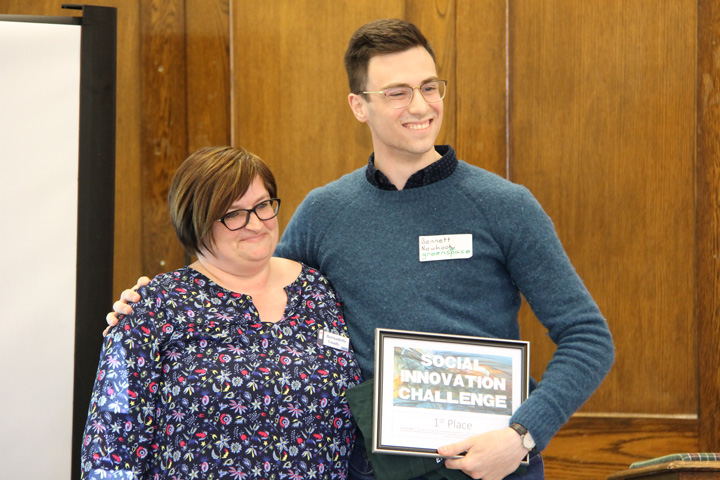 Bennett Newhook, right, won the Social Innovation Challenge recently with Greenspace Urban Farms. He's pictured with judge Bernadette Coady from Metro Business Opportunities.