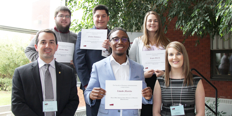 Brad Norman, front left, and Lisa Dillon, front right, representing CIBC, pose with winners of the CIBC Undergraduate Bursary in Business Administration.