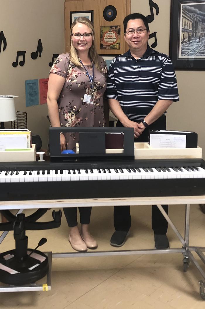 Music therapist Deborah Hawksley and Dr. Leonard Lye with the new piano cart.