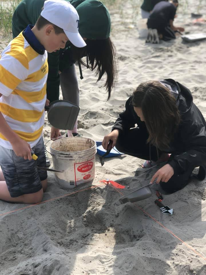 From left: Philip Snow and Melody Lampe participating in a mock archaeology excavation. The students excavated three one-by-one metre excavation units to determine where the ancestors of the Innu and Inuit had been located 3,000 years ago.