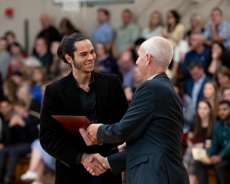 Dr. Mark Abrahams presents a certificate to Phoenix Tashlin Clifford.