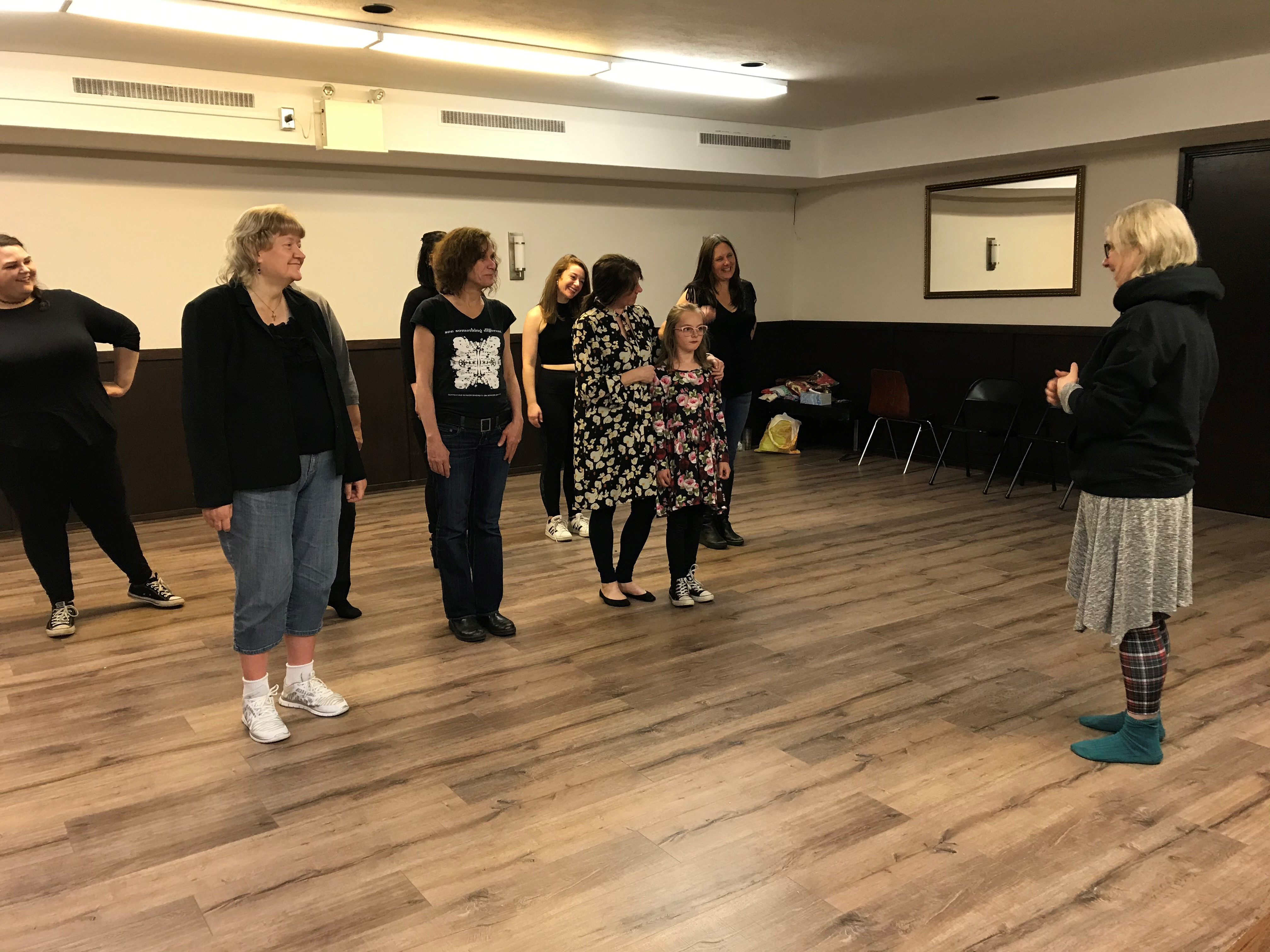 Cast members Laura Bradley, Mary Costello, Wendy Smallwood, Allison Kelly, Ruth Lawrence, Lily Halley-Green and Alexis Koetting, and director Lois Brown in rehearsal.